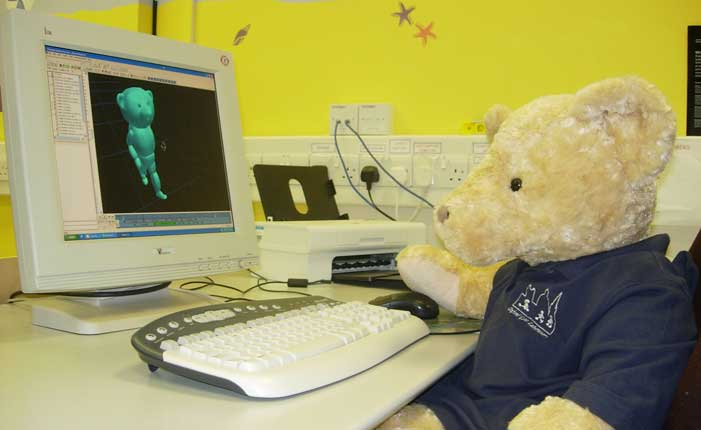Gait Lab - a teddy bear using a computer