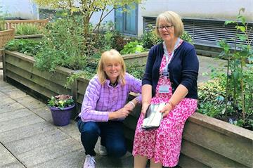 Volunteers join Notcutts Oxford to transform garden at JR