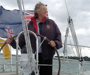Margaret at the helm of a boat